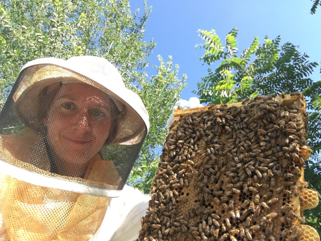 Dr. Eva with a frame from one of her hives.